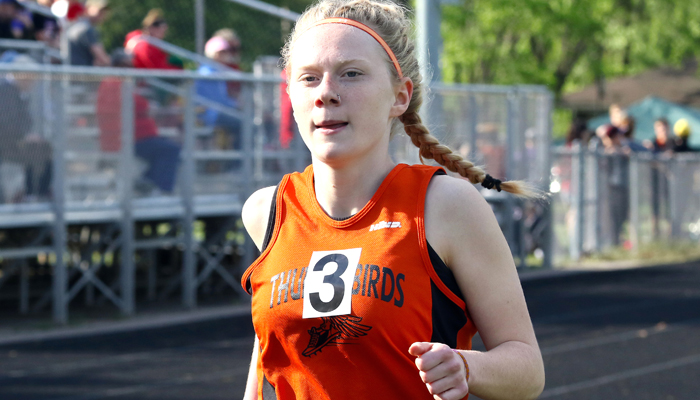 Jada Beacom makes her way around the track for Iola-Scandinavia during the girls' 1,600-meter run. She finished third in 5:44.2 to earn a spot in the race at the Rosholt Sectional.