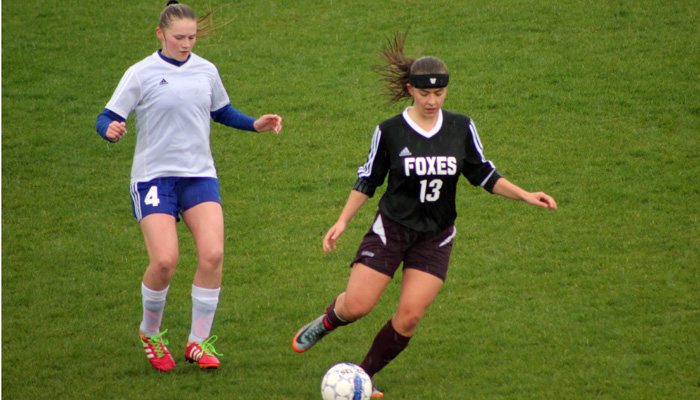 Fox Valley Lutheran's Ali Froehlich controls the ball as Waupaca's Shyla Koshollek moves in. Greg Seubert Photo