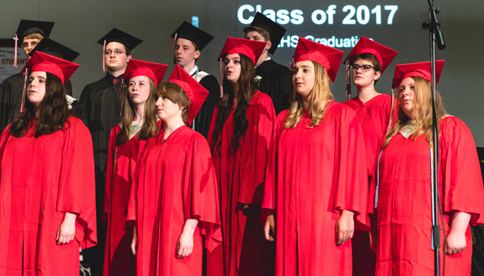 Pictured singing the senior graduation song are Taylor Popke, Mariah Gaboury-Gorges, Courtnie Canterbury, Alison Hidde, Alison Glynn, Madi Polley, Andraia Bieth, Shane Borree, Garrett Solberg, Skyler Palacios and Mat Monty. Ali Garrigan Design photo