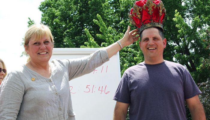 Faye Wilson, left, crowned Jeff Anderson king of the strawberry shortcake eating contest. Anderson donated his winnings to Trinity Lutheran Church.