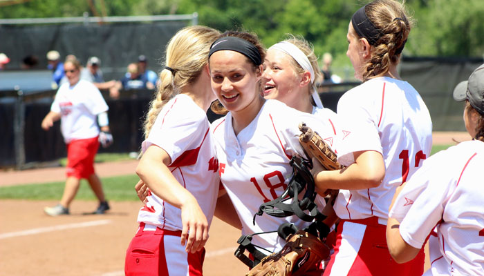 Winning pitcher Kiley Akey celebrates with her Weyauwega-Fremont teammates after she struck out 11 batters in the Indians' 2-0 win over Marshall.
