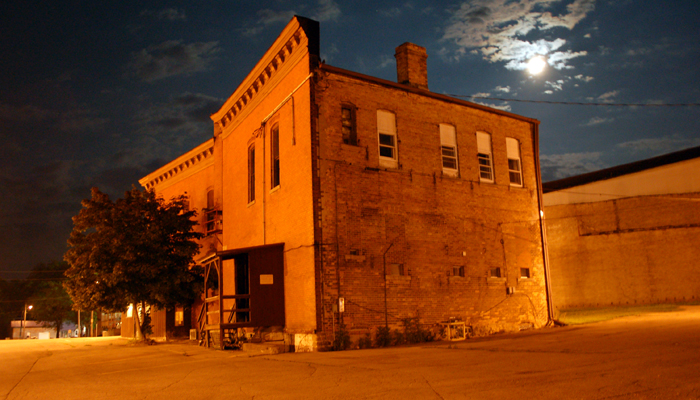 The rear of the city-owned building at 201 S. Pearl St. seen on a moonlit night on July 10. John Faucher photo