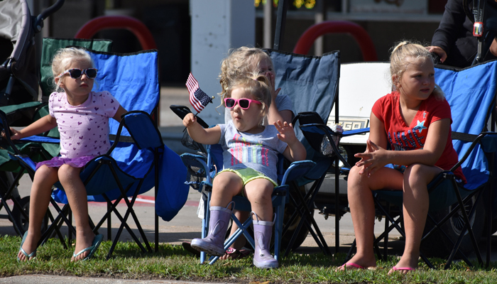 Parade goers wait for the start of the parade Saturday in Scandinavia. 