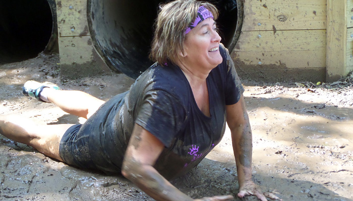"""Kathy Heidemann of Darboy finishes rolling out of the """"Princess Fiona's Fallopian Tubes"""" obstacle.Scott Bellile photo"""