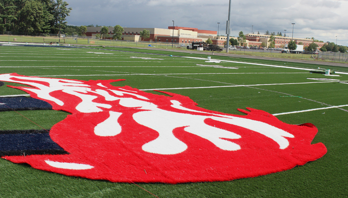 Waupaca High School's logo covers the 50-yard line in the middle of Comet Field. Greg Seubert Photo