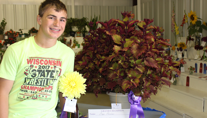 Cian Fischer, Tri-County 4-H Club Club, was a Grand Champion in flowers and house plants.