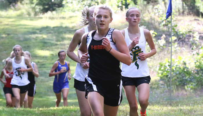 Iola-Scandinavia's Erika Kisting finished third behind Freedom's Jaci Hinz and Lauren Vosters in the girls' race at the Iola-Scandinavia Invitational. Freedom placed five runners in the top 10, while the Thunderbirds also had a top-10 runner in Jada Beacom, who finished fourth. Holly Neumann Photo