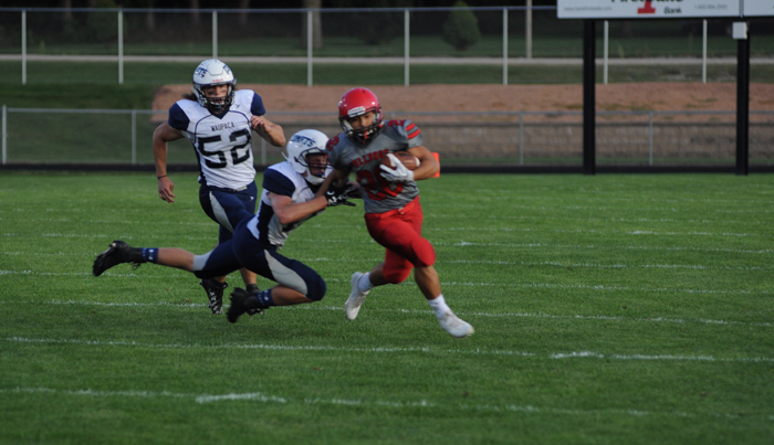 New London running back Makaio Harn breaks a tackle from a Waupaca defender. Erik Buchinger photo