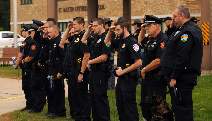 Officers from area police departments meet outside St. Martin Lutheran Church prior to the memorial ceremony to honor K-9 Chero. Erik Buchinger photo