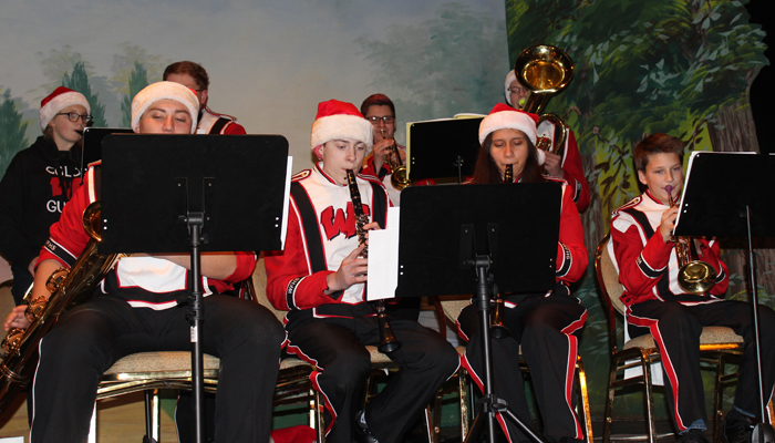Members of the Weyauwega-Fremont High School Band play Christmas tunes in the Gerold Opera House.