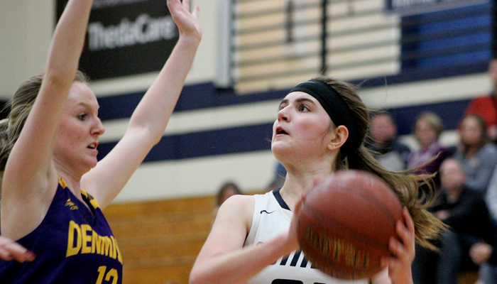 Emma Smidt eyes up the basket in front of Denmark's Hannah Miller. Smidt scored 11 points for Waupaca in a loss to the Vikings. Greg Seubert Photo