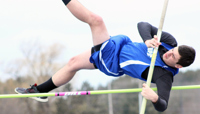 Waupaca's Dillan Russell clears the bar while competing in the boys' pole vault event April 12 at Waupaca High School. Russell tied for 10th in the event and teammate Brad Moloney finished third.Greg Seubert Photo