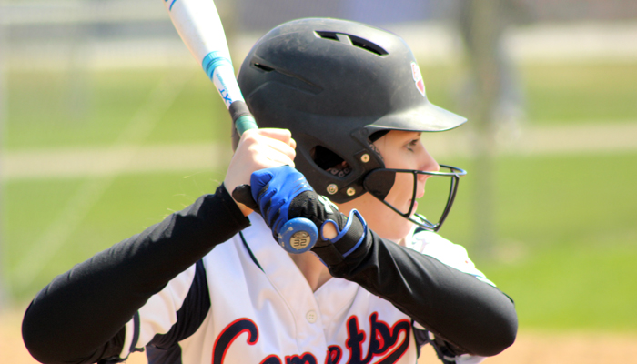 Waupaca's Ireland Grenlie concentrates while batting for the Comets.